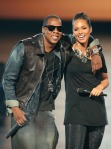 Jay-Z (L) and Alicia Keys performs